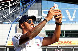 Mercedes' Lewis Hamilton take a picture of the crowd during the paddock day of the 2018 British Grand Prix at Silverstone Circuit, Towcester.