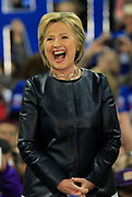 Hillary Clinton laughs as she's introduced prior to her speech at the carpenter's training center in Affton.