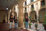 SPAIN, ANDALUSIA, SEVILLE University of Seville located in the famous Tobacco Factory; students in an inner courtyard of the University
