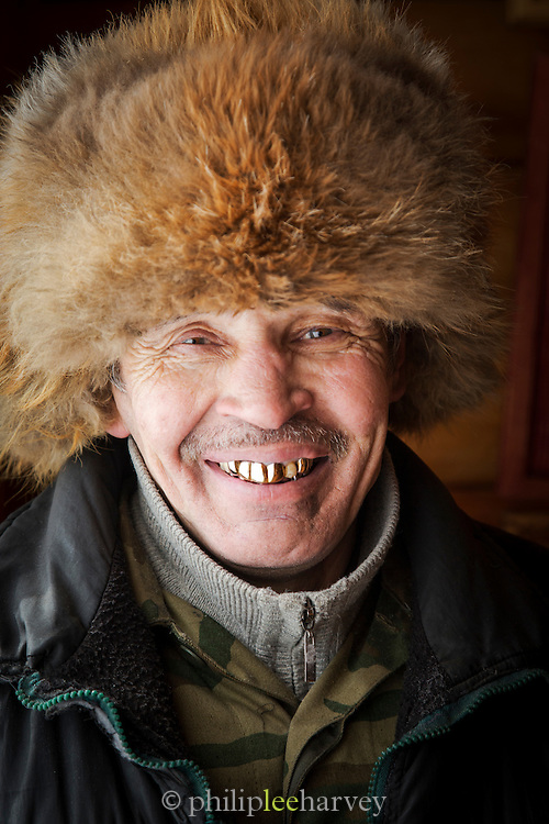 Portrait of an Evenk man in Tynda, the Evenk were traditionally a nomadic people of Siberia. Russia