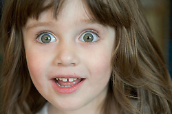 Portrait of an excited young girl,