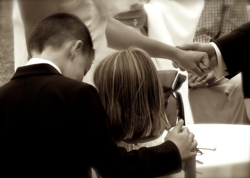 These children, brother and sister, watch as their parents take their wedding vows.