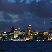 An early evening view of the skyline of the City of Auckland and Auckland Harbour showing Sky Tower. Auckland, North Island, New Zealand. 12th November 2010. Photo Tim Clayton.