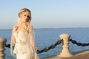 bride by lake erie, rock and roll hall of fame photo by Cleveland wedding photographer Mara Robinson Photography