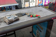 A pump-action water pistol lies on the roof of a bus shelter on the Walworth Road in the borough of Southwark, on 10th August 2017, in London, England.