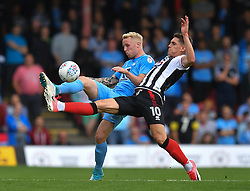 Coventry City's Jack Grimmer (left) battles with Grimsby Town's Sam Jones (right)