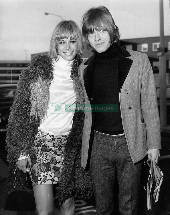 June 13, 2017 - FILE PHOTO - Italian-German actress and model ANITA PALLENBERG (born January 25, 1944 died June 13, 2017) has died at 73. A style icon and 'It Girl' of the 1960s and '70s, Pallenberg was credited as the muse of The Rolling Stones; she was the romantic partner of multi-instrumentalist and guitarist B. Jones, and later, from 1967 to 1980, the partner of Stones guitarist K. Richards, with whom she had three children. Pictured: Dec. 3, 1966 - London, England, U.K. - Rolling Stones guitarist BRIAN JONES with girlfriend ANITA PALLENBERG at Heathrow Airport. Little did the Rolling Stones know how apt their name - inspired by the title of a Muddy Waters song, 'Rollin' Stone' - would turn out to be. Formed in 1962, they are the longest-lived continuously active group in rock and roll history.  (Credit Image: © Keystone Press Agency/Keystone USA via ZUMAPRESS.com)