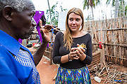 VSO ICS volunteer Josie Kearney learns about looking after ducklings  from Mr Abdul Issa Makolela in her host home. Volunteers stay with local families get the full experience. Lindi, Lindi region. Tanzania.
