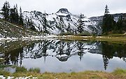 Table Mountain reflects in a pond on the Chain Lakes Loop Trail, near Austin Pass Visitor Center, in Heather Meadows, Mount Baker Snoqualmie National Forest, Washington, USA