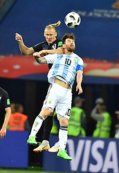 June 21, 2018 - Nizhny Novgorod, Russia - LIONEL MESSI (R) of Argentina competes for a header with DOMAGOJ VIDA of Croatia during the 2018 FIFA World Cup Group D match between Argentina and Croatia in Nizhny Novgorod, Russia, June 21, 2018. Croatia won 3:0. (Credit Image: © Li Ga/Xinhua via ZUMA Wire)