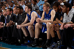 CHAPEL HILL, NC - MARCH 05: (L-R in jerseys) Ryan Kelly #34 and Mason Plumlee #5 of the Duke Blue Devils sit on the bench while playing the North Carolina Tar Heels on March 05, 2011 at the Dean E. Smith Center in Chapel Hill, North Carolina. North Carolina won 67-81. (Photo by Peyton Williams/UNC/Getty Images) *** Local Caption *** Ryan Kelly;Mason Plumlee