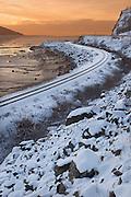 USA, Alaska, Turnagain Arm, Seward Highway, Sunrise view of the Alaska Railroads tracks along the Turnagain Arm in winter just south of Anchorage.