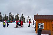 People skiing and preparing to ski at Keystone Ski Resort, Keystone, Colorado, USA.