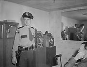 Y-480923-02.  Slot machine raid. Detective Mike Elliot. 3 Star Tavern, 8343 SW Barbur Blvd (now site of the Boom Boom Room) September 23, 1948