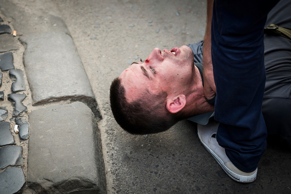 After a brief chase through the street, two police officers, with the help of a couple civilians, subdue and arrest a man in Lviv, Ukraine.<br /> <br /> (September 2016)