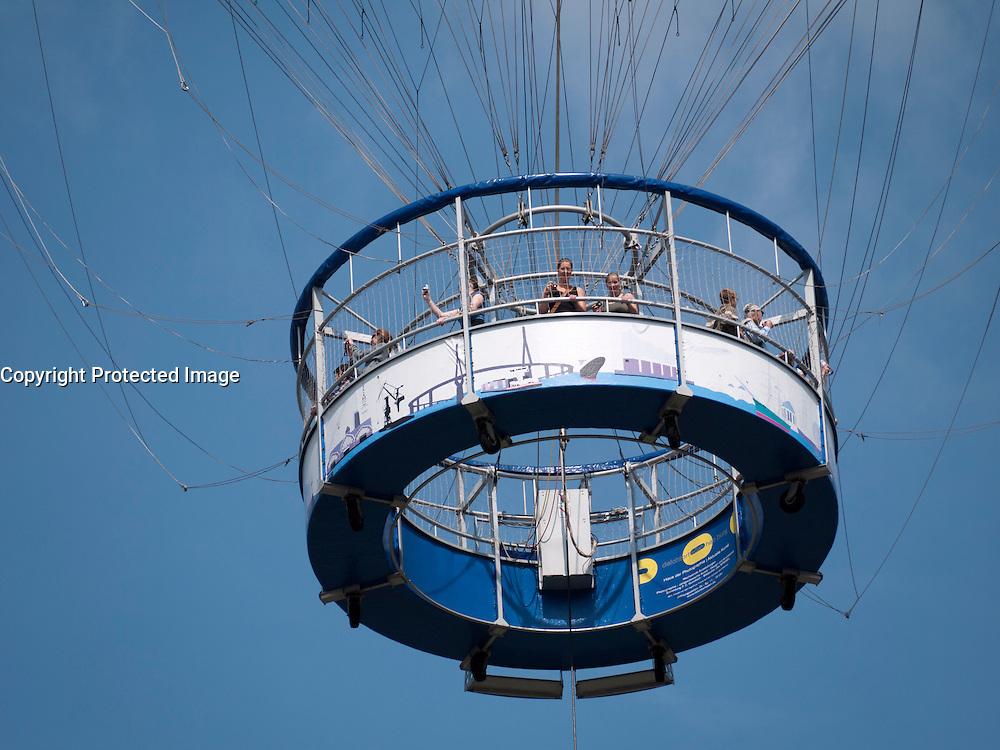 Tourists on sightseeing balloon ride above Hamburg in Germany