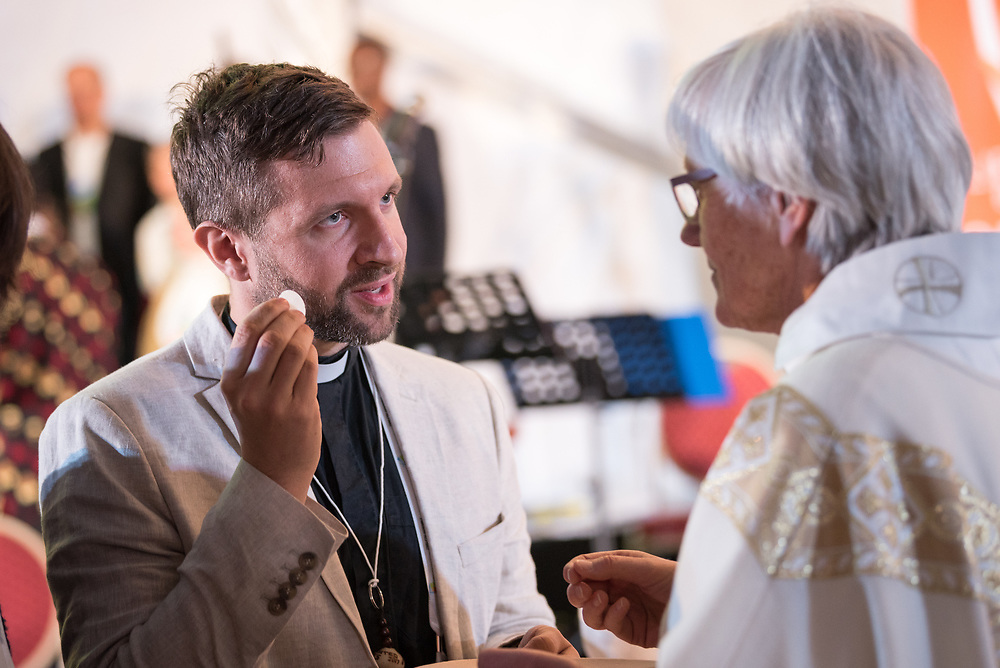 """16 May 2017, Windhoek, Namibia: Church of Sweden Archbishop Antje Jackelén received Holy Communion. As the Twelfth Assembly of the Lutheran World Federation is coming to an end, a closing worship service celebrates the LWF Communion and a successful Assembly, and installing the newly elected LWF Council and President. The Twelfth Assembly of the Lutheran World Federation gathers in Windhoek, Namibia, on 10-16 May 2017, under the theme """"Liberated by God's Grace"""", bringing together some 800 delegates and participants from 145 member churches in 98 countries."""