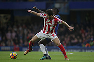 Ramadan Sobhi of Stoke City and Victor Moses of Chelsea battle for the ball.<br /> Premier league match, Chelsea v Stoke city at Stamford Bridge in London on Saturday 30th December 2017.<br /> pic by Kieran Clarke, Andrew Orchard sports photography.
