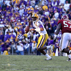 November 6, 2010; Baton Rouge, LA, USA;  LSU Tigers quarterback Jordan Jefferson (9) is pursued by Alabama Crimson Tide defensive tackle Marcell Dareus (57) during the second half at Tiger Stadium. LSU defeated Alabama 24-21.  Mandatory Credit: Derick E. Hingle