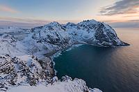 Winter view over Kvalvika beach from the summit of Ryten, Moskenesøy, Lofoten Islands, Norway