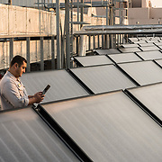 Hotel engineer working on solar panels at the Hilton Hotel in Dubai