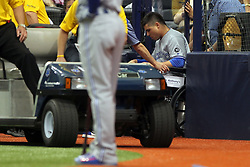 May 6, 2018 - St. Petersburg, FL, U.S. - ST. PETERSBURG, FL - MAY 06: Aledmys Diaz (1) of the Blue Jays is taken off the field after he went to the ground after safely running to first base during the MLB regular season game between the Toronto Blue Jays and the Tampa Bay Rays on May 06, 2018, at Tropicana Field in St. Petersburg, FL. (Photo by Cliff Welch/Icon Sportswire) (Credit Image: © Cliff Welch/Icon SMI via ZUMA Press)