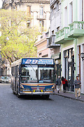 in the San Telmo district around Plaza Dorrego Square, a local bus painted in bright colours number 29, old Mercedes. Calle Defensa Defence street Buenos Aires Argentina, South America