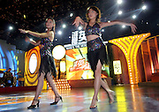 """CHANGSHA, HUNAN - 03 NOVEMBER 2005 - Chinese dancers perform on the set of the game show called """"Who's the Hero"""" at Hunan TV. Chinaís entry into WTO seems to present a daunting scenario to Chinese media officials, in which the fledging Chinese media industry is placed at the mercy of global media giants with all concomitant implications to the Chinese culture, the state sovereignty, ideological hegemony and social stability.  Photo by Natalie Behring"""