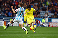 Alex Mowatt of Leeds united (r) shoots and scores his teams 3rd goal. Skybet football league Championship match, Huddersfield Town v Leeds United at the John Smith's Stadium in Huddersfield, Yorks on Saturday 7th November 2015.<br /> pic by Chris Stading, Andrew Orchard sports photography.