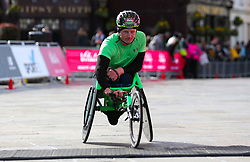 Simon Lawson finishes secong in the men's wheelchair race during the Vitality Big Half in London.