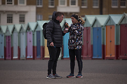 © Licensed to London News Pictures.  03/05/2021. Brighton, UK. Members of the public walk along cost line of Brighton Beach in East Sussex, following The May Day, bank holiday as forecasts predict strong winds and rain for the coming week. Photo credit: Marcin Nowak/LNP