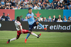 May 31, 2017 - New England Revolution defender ANGOUA BROU BENJAMIN (4) fouls New York City FC defender BEN SWEAT (2) while making an attempt on goal during regular season play at Yankee Stadium in Bronx, NY. (Credit Image: © Mark Smith via ZUMA Wire)