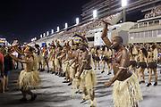 Men dressed as cavemen dancing for Salgueiro Samba School doing the final practice performance of their Carnival procession in the Sambadrome, Rio de Janeiro, Brazil