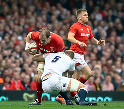Alun Wyn Jones of Wales is tackled by George Kruis of England<br /> <br /> Photographer Simon King/Replay Images<br /> <br /> Six Nations Round 3 - Wales v England - Saturday 23rd February 2019 - Principality Stadium - Cardiff<br /> <br /> World Copyright © Replay Images . All rights reserved. info@replayimages.co.uk - http://replayimages.co.uk