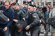 Moscow, Russia, 31/08/2010..Police arrest a demonstrator as they break up an opposition protest in central Moscow and arrest around 70 people. Opposition activists hold regular demonstrations on the 31st day of the month, protesting against restrictions on the freedom of assembly, which is protected by article number 31 of the Russian constitution.