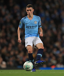 """Manchester City's Phil Foden during the Carabao Cup, Fourth Round match at the Etihad Stadium, Manchester. PRESS ASSOCIATION Photo. Picture date: Thursday November 1, 2018. See PA story SOCCER Manchester. Photo credit should read: Mike Egerton/PA Wire. RESTRICTIONS: EDITORIAL USE ONLY No use with unauthorised audio, video, data, fixture lists, club/league logos or """"live"""" services. Online in-match use limited to 120 images, no video emulation. No use in betting, games or single club/league/player publications."""