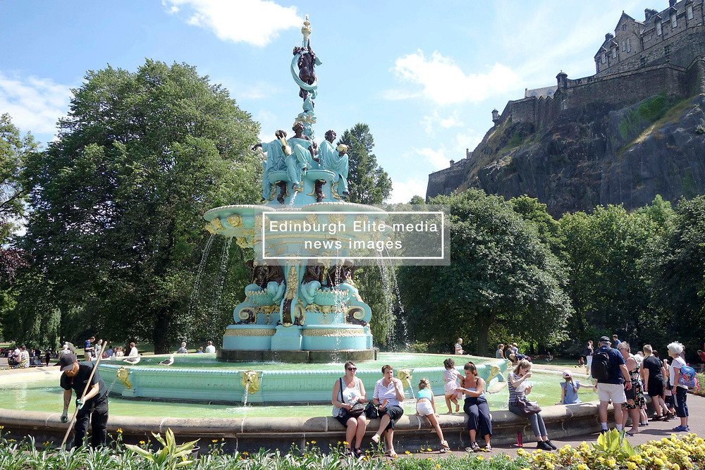 Edinburgh Weather<br /> <br /> Crowds of people enjoyed what co u  ld turn out to be the hottest day of t hge year.<br /> <br /> Children cooled off by playing in the newly-restored Ross Fountain whilst adults soaked up the sun and relaxed<br /> <br /> Alex Todd | EEm