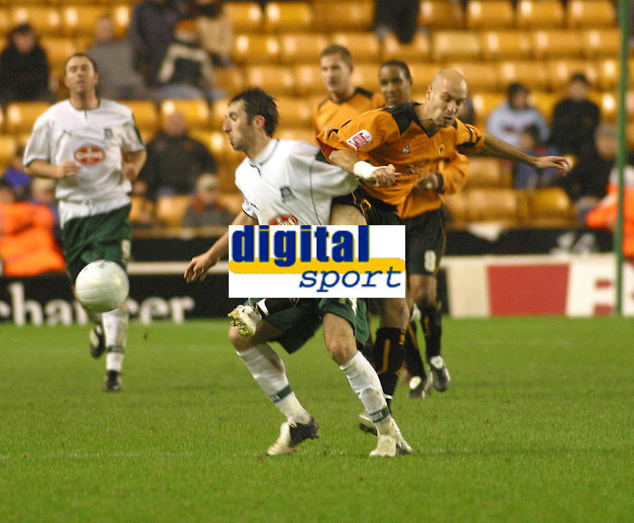 Photo: Dave Linney.<br />Wolverhampton Wanderers v Plymouth Argyle. The FA Cup.Wolves Denes Rosa(R) bundles the ball past   Tony Capaldi<br />07/01/2006.