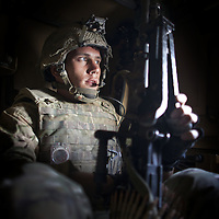 British soldiers of 16 Air Assault Bde's elite BRF (Brigade Reconnaissance Force) traveling in a Warthog tracked vehicle move from compound to compound searching for weapons and explosives as part of an operation in the Western Dasht, Helmand Province, Southern Afghanistan on the 18th of March 2011.