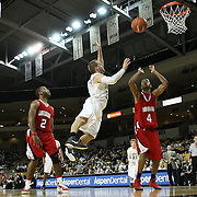 Central Florida guard A.J. Rompza (3) drives to the basket against Louisiana's guard Randell Daigle (2) and Louisiana's forward Scottie Farrington (4) during their game at the UCF Arena on December 15, 2010 in Orlando, Florida. UCF won the game79-58. (AP Photo/Alex Menendez)
