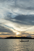 Canoe at sunset, Lake Murray, Middle Fly District, Western Province, Papua New Guinea
