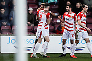 Doncaster Rovers forward Mallik Wilks (7), on loan from Leeds United scores a goal and celebrates to make the score 0-1 during the EFL Sky Bet League 1 match between Scunthorpe United and Doncaster Rovers at Glanford Park, Scunthorpe, England on 23 February 2019.