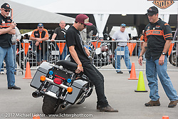 Rob Grimsley, a Harley-Davidson Regional Police Rep, explains how to pick up a bike with very little effort to Terra Green, New Orleans, LA at the Harley-Davidson Display during Daytona Bike Week. Daytona Beach, FL. USA. Monday March 13, 2017. Photography ©2017 Michael Lichter., explains how to pick up a bike with very little effort to Terra Green, New Orleans, LA at the Harley-Davidson Display during Daytona Bike Week. Daytona Beach, FL. USA. Monday March 13, 2017. Photography ©2017 Michael Lichter., explains how to pick up a bike with very little effort to Terra Green, New Orleans, LA at the Harley-Davidson Display during Daytona Bike Week. Daytona Beach, FL. USA. Monday March 13, 2017. Photography ©2017 Michael Lichter., explains to Wall of Death rider Cody Ives how to pick up a bike with very little effort at the Harley-Davidson Display during Daytona Bike Week. Daytona Beach, FL. USA. Monday March 13, 2017. Photography ©2017 Michael Lichter.
