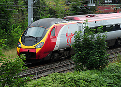 Embargoed to 1300 Thursday November 01 File photo dated 15/08/12 of a Virgin train, as the company has permanently scrapped its Friday afternoon peak restrictions from London Euston to ease overcrowding and enable weekend getaways to start earlier.