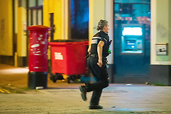 © Licensed to London News Pictures . 26/09/2017. Brighton, UK. Police run to reports of a fight in Steine Gardens in the Kemptown area of the city . Revellers at the end of a night out in Brighton during Freshers week , when university students traditionally enjoy the bars and clubs during their first nights out in a new city . Photo credit: Joel Goodman/LNP