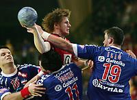 Alexander Buchmann (NOR) gegen Danijel Andelkovic, Alem Toskic und Momir Ilic (SCG) © Andy Mueller/EQ Images