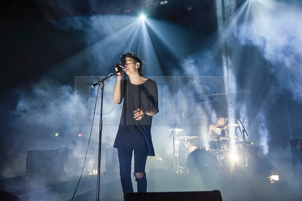 """© Licensed to London News Pictures. 09/01/2014. London, UK.   The 1975 performing live at Brixton Academy.  In this picture - Matthew Healy (left) and George Daniel (right). . The 1975 are an English alternative rock/indie rock band from consisting of members Matthew Healy (vocals, guitar), Adam Hann (guitar), George Daniel (drums), and Ross MacDonald (bass).  They are touring to promote their debut studio album """"The 1975"""".  Photo credit : Richard Isaac/LNP"""