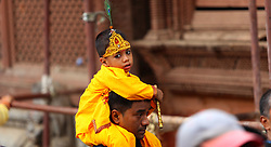 August 8, 2017 - Kathmandu, Nepal - A Nepalese kid dressed as Lord Krishna take part in  celebration of Gaijatra festival or the festival of cows in Kathmandu. Hindus celebrated the festival in commemorate of the death loved ones and pray for peace soul honouring cows or decorate people as cow in the streets. (Credit Image: © Archana Shrestha/Pacific Press via ZUMA Wire)