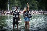 WASHINGTON, DC -- 8/28/20 -- March participants cool off in the Reflecting Pool during the program.<br /> The 57th Anniversary March on Washington drew thousands to the National Mall to hear activists speak at the Lincoln Memorial .…by André Chung #_AC20157
