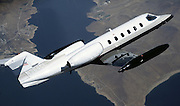 Lear 35-A business jet in the air.